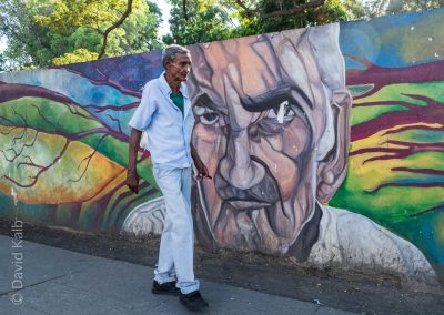 Cuban man and mural